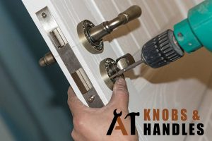 green-drill-being-used-on-door-knob-handle-installation-a1-knobs-&-handles-singapore
