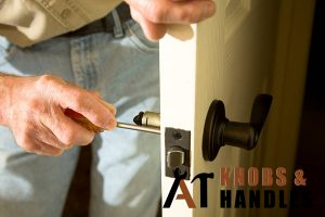 worker-in-jeans-performing-door-knob-handle-installation-a1-knobs-&-handles-singapore