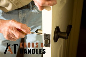 worker-in-jeans-performing-door-knob-handle-installation-a1-knobs-&-handles-singapore_featured